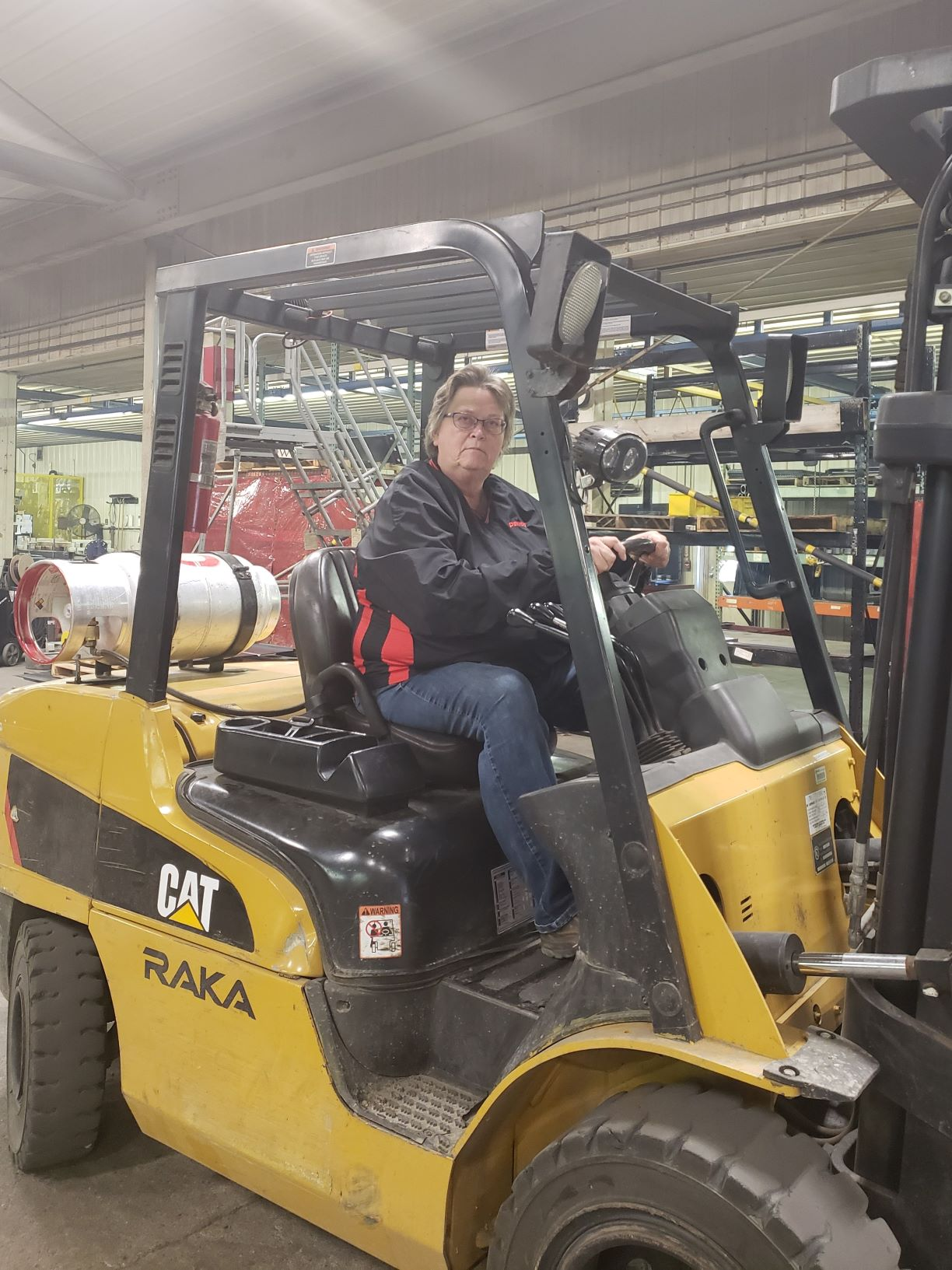 Kathy Kunzmann in the Demco Products facility